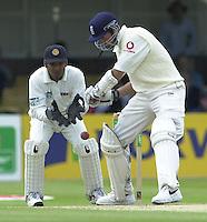 31/05/2002.Sport -Cricket - 2nd NPower Test -Second Day.England vs Sri Lanka.Marcus Trescothick batting and Kumar Sangakkara keeping wicket. [Mandatory Credit Peter Spurrier:Intersport Images]