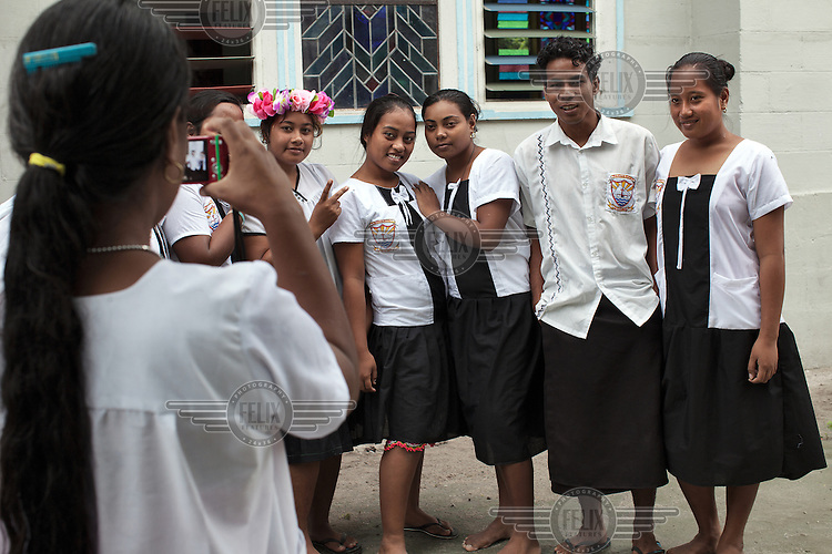 Students from a Catholic secondary school pose for a photograph.