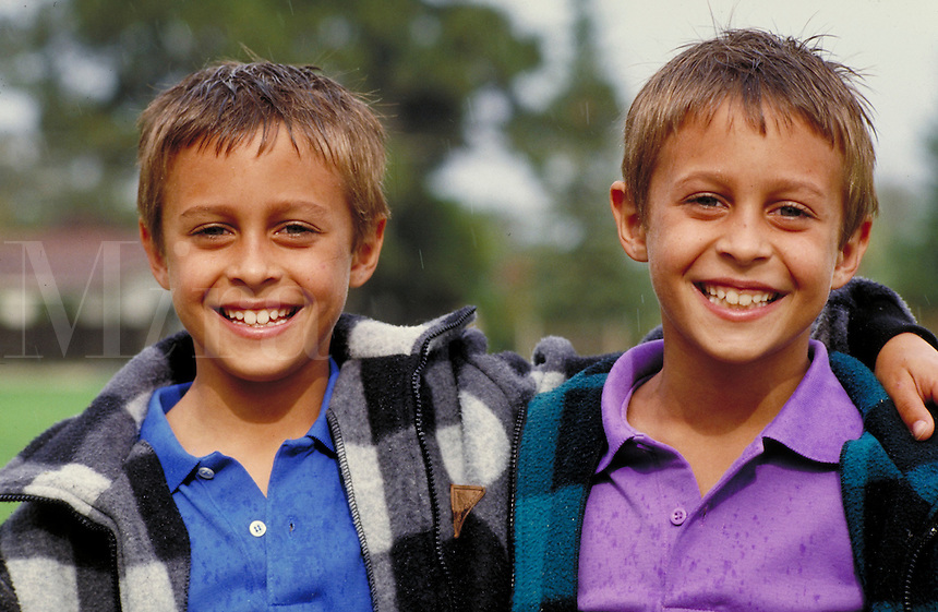 CAUCASIAN IDENTICAL TWINS. IDENTICAL TWIN BOYS. SAN FRANCISCO CALIFORNIA USA.