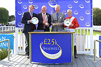 Connections of Dark Lady receive their trophies after winning The Shadwell Dick Poole Fillies' Stakes during Racing at Salisbury Racecourse on 5th September 2019