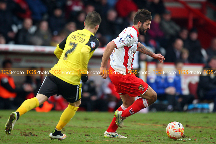 Dean Wells of Stevenage and Jamie Cureton of Dagenham and Redbridge - Stevenage vs Dagenham and Redbridge - Sky Bet League Two football at he Lamex Stadium on 21/03/15 - MANDATORY CREDIT: Dave Simpson/TGSPHOTO - Self billing applies where appropriate - 0845 094 6026 - contact@tgsphoto.co.uk - NO UNPAID USE