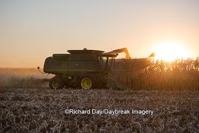 63801-06803 John Deere combine harvesting corn at sunset, Marion Co., IL