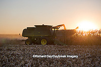 63801-06803 John Deere combine harvesting corn at sunset, Marion Co., IL