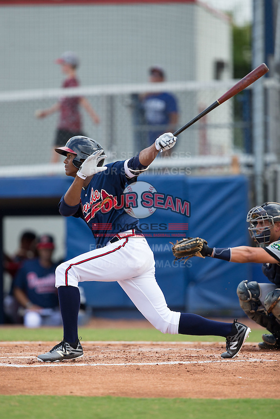 Cristian Pache (15) of the Danville Braves follows through on his swing against the Pulaski Yankees at American Legion Post 325 Field on July 31, 2016 in Danville, Virginia.  The Yankees defeated the Braves 8-3.  (Brian Westerholt/Four Seam Images)