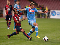 Naples's   Hugo Campagnaro challenged by Genoa 's  Matuzalemme during their Italian Serie A soccer match at the San Paolo  stadium in Naples April 7, 2013