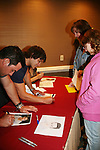 Tyler Christopher - General Hospital looks at drawing done by fan Kaitlyn at Uncle Vinny's/Ferraras at the Crown Plaza in Trevose, Pennsylvania on April 22, 2010 to see fans with a q & a and autographs and taking of photos. (Photo by Sue Coflin/Max Photos0