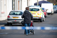 Tuesday 18 February 2014<br /> Pictured: A woman walks along the cordoned off New Road in Pontyberem<br /> Re:A dog has been seized by police following the sudden death of a baby in Carmarthenshire.Officers say they had a call alerting them to the incident at a property in New Road, Pontyberem, shortly before 08:30 GMT on Tuesday.The baby was airlifted to the University Hospital of Wales, Cardiff, the Welsh Ambulance Service said.The dog involved in the incident was an Alaskan Malamute, similar to a Husky, which is not a banned breed.