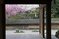 "A view from the ""hojo"" or monks' quarters towards a collection of stone clusters in the Ryoan-Ji Temple garden"
