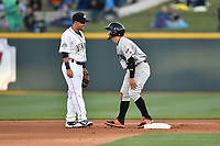 Shortstop Michael Paez (3) of the Columbia Fireflies, left, meets up with former Coastal Carolina teammate Anthony Marks (29) of the Augusta GreenJackets at second base on Opening Day, Thursday, April 6, 2017, at Spirit Communications Park in Columbia, South Carolina. As teammates in 2016 they won an NCAA National Championship. Columbia won, 14-7. (Tom Priddy/Four Seam Images)