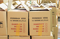 Boxes with bottles. Text indicating if it is Cabernet, Merlot, Sangiovese or Muscat wine bottles. Kantina Miqesia or Medaur winery, Koplik. Albania, Balkan, Europe.