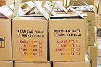 Boxes with bottles. Text indicating if it is Cabernet, Merlot, Sangiovese or Muscat wine bottles. Kantina Miqesia or Medaur winery, Koplik. Albania, Balkan, Europe.