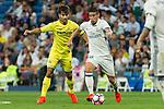 Real Madrid's James Rodriguez and Villarreal's Manuel Trigueros during the match of La Liga between Real Madrid  and Villarreal Club de Futbol at Santiago Bernabeu Estadium in Madrid. September 21, 2016. (ALTERPHOTOS/Rodrigo Jimenez)