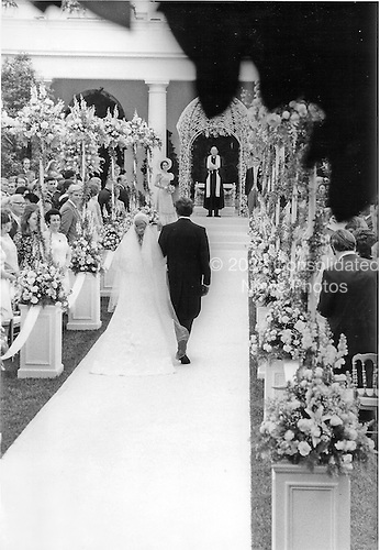Washington, DC - June 12, 1971 -- United States President Richard M. Nixon walks his daughter, Tricia, down the aisle in the Rose Garden of the White House in Washington, D.C. on Saturday, June 12, 1971 shortly before she was married to Edward Cox in a White House ceremony.  Julie Nixon Eisenhower waits at the alter for her sister..Credit: Pool via CNP