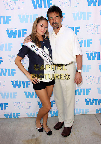 TAMI FARRELL - MISS CALIFORNIA USA & JOE MANTEGNA .12th Annual Women In Film Celebrity Golf Classic held At The Malibu Country Club, Malibu, California, USA, .11th July 2009..Full length sash blue cardigan white top shorts ballet pumps flats shoes two tone hand on hip shirt .CAP/ADM/KB.©Kevan Brooks/Admedia/Capital Pictures