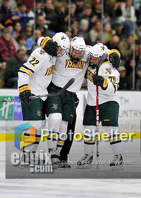 3 December 2011: University of Vermont Catamount forward Kyle Mountain, a Freshman from Bryn Mawr, PA, is helped off the ice by teammates Blake Doerring (22) and Brett Leonard (26) after suffering a right leg injury during game action against the University of Maine Black Bears at Gutterson Fieldhouse in Burlington, Vermont. The Catamounts fell to the Black Bears 5-2 in the second game of their 2-game Hockey East weekend series. Mandatory Credit: Ed Wolfstein Photo