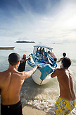 INDONESIA, Mentawai Islands, Kandui Surf Resort, surfers loading a boat to go surfing for the day, Indian Ocean
