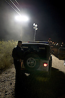 Border patrol agent near the border fence...Nogales, AZ..12/10/05..photo: Hector Emanuel