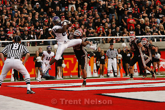 Trent Nelson  |  The Salt Lake Tribune.TCU's Jimmy Young pulls down a touchdown pass ahead of Utah defender Chaz Walker during the second half, Utah vs. TCU college football, Saturday, November 6, 2010. TCU won 47-7.