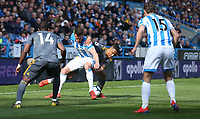 Leicester City's Youri Tielemans battles with Huddersfield Town's Jonathan Hogg <br /> <br /> <br /> Photographer Stephen White/CameraSport<br /> <br /> The Premier League - Huddersfield Town v Leicester City - Saturday 6th April 2019 - John Smith's Stadium - Huddersfield<br /> <br /> World Copyright © 2019 CameraSport. All rights reserved. 43 Linden Ave. Countesthorpe. Leicester. England. LE8 5PG - Tel: +44 (0) 116 277 4147 - admin@camerasport.com - www.camerasport.com