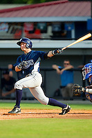 Hunter Lockwood (15) of the Princeton Rays follows through on his swing against the Burlington Royals at Burlington Athletic Park on July 5, 2013 in Burlington, North Carolina.  The Royals defeated the Rays 5-1 in game one of a doubleheader.  (Brian Westerholt/Four Seam Images)
