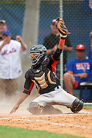 Miami Marlins catcher Pablo Garcia (5) shows the umpire the ball after tagging out Tim Tebow (not shown) at home during an Instructional League game against the New York Mets on September 29, 2016 at the Port St. Lucie Training Complex in Port St. Lucie, Florida.  (Mike Janes/Four Seam Images)