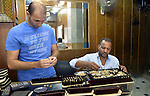 Egyptian vendors display jewellery at his jewellery store, in cairo, Egypy, on  October 19, 2016. Decline in demand for gold in the Egyptian markets due to the high price. Photo by Amr Sayed