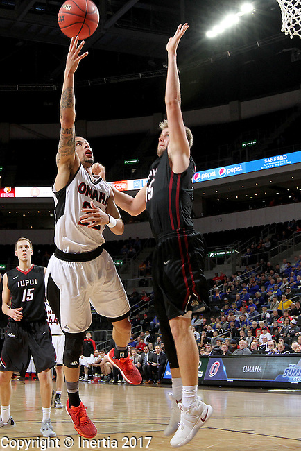 SIOUX FALLS, SD: MARCH 6: 	Marcus Tyus #23 from Omaha shoots over the defense of Matt O'Leary #15 from IUPUI during the Summit League Basketball Championship on March 6, 2017 at the Denny Sanford Premier Center in Sioux Falls, SD. (Photo by Dave Eggen/Inertia)
