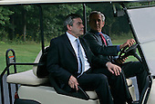CAMP DAVID, MD - JULY 29: (AFP OUT) U.S. President George W. Bush (R) gives British Prime Minister Gordon Brown a ride in a golf cart after he arrived July 29, 2007 in Camp David, Maryland. The two leaders will attend meetings to discuss many topics including the situation in Iraq and Afghanistan.  (Photo by Mark Wilson/Getty Images)