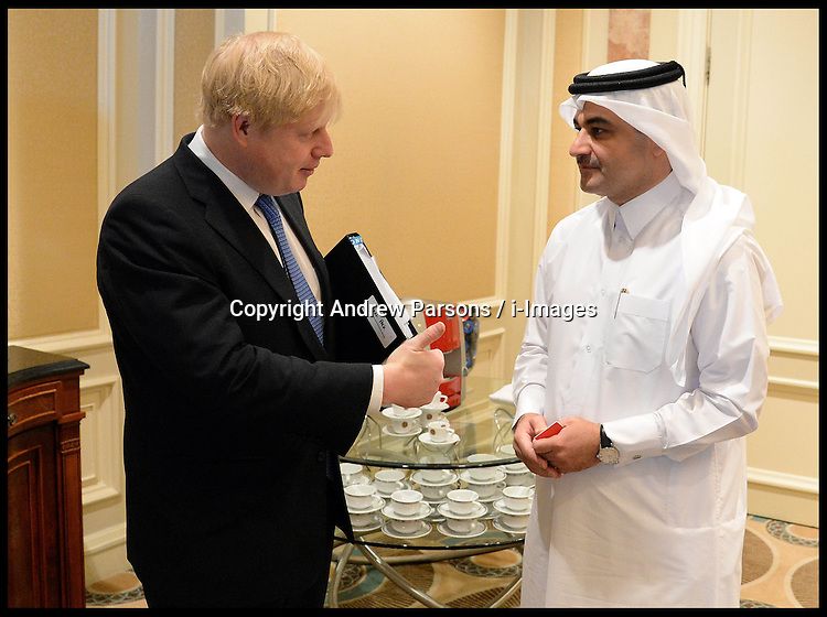 The London Mayor Boris Johnson meets Engr Nasser Ali Al-Mawlawi President of Public Works Authority in Doha, Qatar. After Boris opened the Institute for Infrastructure Studies in Doha. On the second day of his 3 day tour of Qatar Tour. Saturday 20 April, 2013, Photo by: Andrew Parsons / i-Images