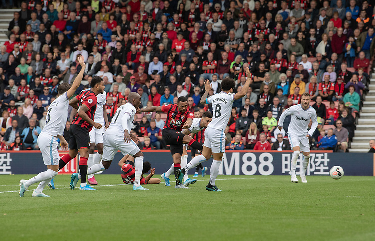 Bournemouth's Callum Wilson (centre) strikes the ball to scores his side's second goal and gives Bournemouth a 2-1 lead<br /> <br /> Photographer David Horton/CameraSport<br /> <br /> The Premier League - Bournemouth v West Ham United - Saturday 28th September 2019 - Vitality Stadium - Bournemouth<br /> <br /> World Copyright © 2019 CameraSport. All rights reserved. 43 Linden Ave. Countesthorpe. Leicester. England. LE8 5PG - Tel: +44 (0) 116 277 4147 - admin@camerasport.com - www.camerasport.com