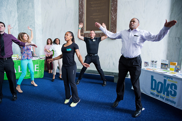 "UNITED STATES - MAY 20: Rep. Marc Veasey, D-Texas, participates in a work out during the ""2014 Health and Fitness Expo,"" that Veasey hosted in Rayburn, May 20, 2014. (Photo By Tom Williams/CQ Roll Call)"