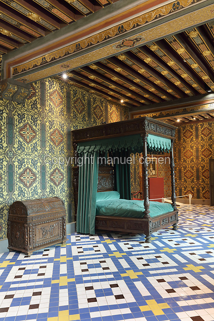Chambre de la Reine or Queen's Bedroom, decorated in 16th century Renaissance style and restored by Felix Duban in 1861-66, on the first floor of the Francois I wing, built early 16th century in Italian Renaissance style, at the Chateau Royal de Blois, built 13th - 17th century in Blois in the Loire Valley, Loir-et-Cher, Centre, France. This is thought to be the room in which Catherine de Medici died in 1589, and the walls are decorated with her monogram, 2 Cs with an H for Henri II. It has a painted ceiling, tiled floor and 4-poster bed with a green canopy. The chateau has 564 rooms and 75 staircases and is listed as a historic monument and UNESCO World Heritage Site. Picture by Manuel Cohen