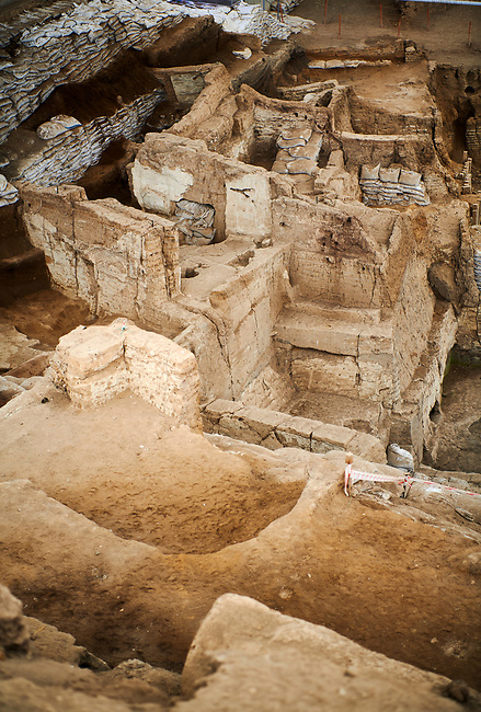looking down from the highest point of the south area across the Neolithic remains of mud brick houses walls. In the centre it can be seen how deep the excavation has gone so far. 7500 BC to 5700 BC, Catalyhoyuk Archaeological Site, Çumra, Konya, Turkey