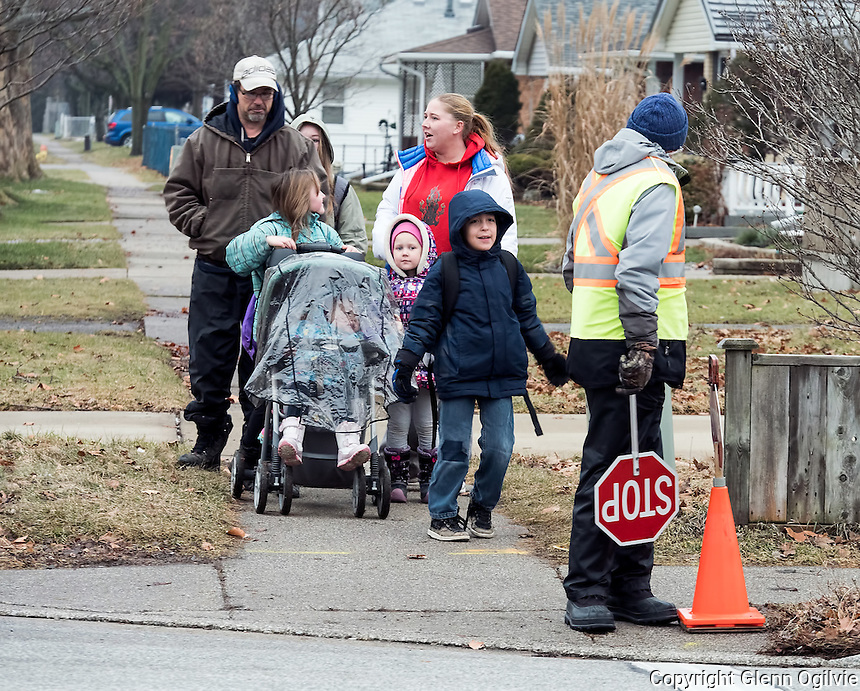 Philip Miller, has been a crossing guard for 14 years and currently works at the intersection of Indian Road and Oak Street. Crossing the Indian Road crossing are Rob Bareness and his daughter Melissa Duguay, 8, Stacey Passingham and her children Lexi Dennis, 5 and Zoe Dennis, 2, in the buggy. Dark coat is Issac Nahmabin, 9.