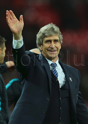 28.02.2016. Wembley Stadium, London, England. Capital One Cup Final. Manchester City versus Liverpool. Manchester City Manager Manuel Pellegrini celebrates winning the Capital One Cup Final
