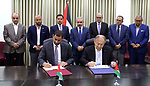 Palestinian Prime Minister Mohammad Ishtayeh attend the signing of increasing trade and enhancing economic cooperation agreements with Jordan, in the West Bank city of Ramallah, July 30, 2019. Photo by Prime Minister Office