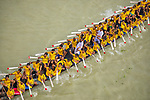 Rowers in brightly coloured shirts compete in a traditional dragon boat race as thousands gather on smaller vessels to cheer them on.  Dozens of competitors cram on to the 200ft long, thin boats, wearing colourful pink, green and yellow shirts.<br /> <br /> The traditional Bangladeshi boat race, known as Nouka Baich, sees teams from regions across the country competing to win a cash prize.  Photographer Azim Khan Ronnie used his drone to capture stunning images of a race on the Meghna river in Daudkandi, Comilla, Bangladesh.  SEE OUR COPY FOR DETAILS.<br /> <br /> Please byline: Azim Khan Ronnie/Solent News<br /> <br /> © Azim Khan Ronnie/Solent News & Photo Agency<br /> UK +44 (0) 2380 458800