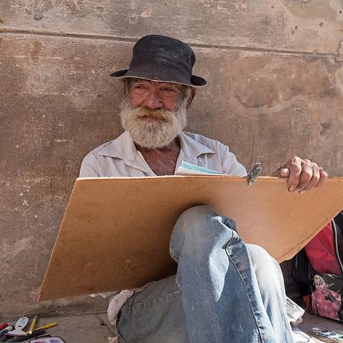 Artist near the cathedral, La Habana Vieja