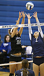 Marymount's Emileigh Rettig blocks in a college volleyball game, in Arlington, Vir., on Saturday, Nov. 1, 2014.<br /> Photo by Cathleen Allison