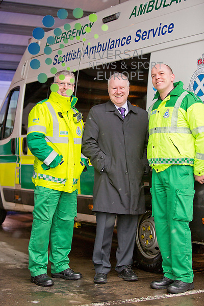 Health Secretary, Alex Neil, talks to paramedics, marking the start of patients being able to share their experience of using Scotland's health services online...Pictured Derek Young (left), Alex Neil (centre) and Ricky Paton (right)...Malcolm McCurrach | Universal News and Sport | 19/03/2013