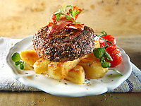 Peppered beef burger on thick cut chips photos. Funky Stock Photos