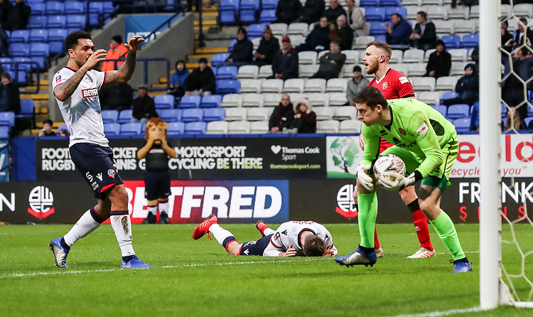 Bolton Wanderers' Josh Magennis and Luke Murphy rue a missed opportunity as Walsall's goalkeeper Liam Roberts saves<br /> <br /> Photographer Andrew Kearns/CameraSport<br /> <br /> Emirates FA Cup Third Round - Bolton Wanderers v Walsall - Saturday 5th January 2019 - University of Bolton Stadium - Bolton<br />  <br /> World Copyright © 2019 CameraSport. All rights reserved. 43 Linden Ave. Countesthorpe. Leicester. England. LE8 5PG - Tel: +44 (0) 116 277 4147 - admin@camerasport.com - www.camerasport.com