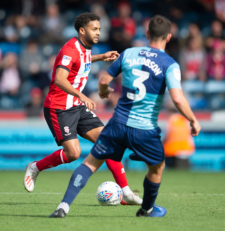 Lincoln City's Bruno Andrade vies for possession with Wycombe Wanderers' Joe Jacobson<br /> <br /> Photographer Andrew Vaughan/CameraSport<br /> <br /> The EFL Sky Bet League One - Wycombe Wanderers v Lincoln City - Saturday 7th September 2019 - Adams Park - Wycombe<br /> <br /> World Copyright © 2019 CameraSport. All rights reserved. 43 Linden Ave. Countesthorpe. Leicester. England. LE8 5PG - Tel: +44 (0) 116 277 4147 - admin@camerasport.com - www.camerasport.com