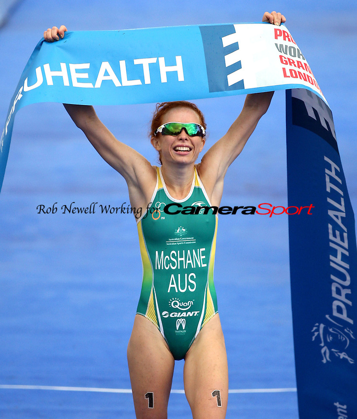 Winner Charlotte Mcshane of Australia celebrates - 2013 ITU World Triathlon Grand Final U23 Women at Hyde Park, London - 12/09/13 - MANDATORY CREDIT: Rob Newell/TGSPHOTO - Self billing applies where appropriate - 0845 094 6026 - contact@tgsphoto.co.uk - NO UNPAID USE