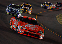 Apr 22, 2006; Phoenix, AZ, USA; Nascar Nextel Cup driver Tony Stewart of the (20) Home Depot Chevrolet Monte Carlo leads Jimmy Johnson during the Subway Fresh 500 at Phoenix International Raceway. Mandatory Credit: Mark J. Rebilas-US PRESSWIRE Copyright © 2006 Mark J. Rebilas..