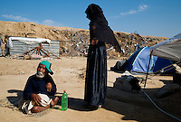 Al Tufa'ah, Gaza Strip, 22 Nov 2009.Mohammed Maasalam and Kefaia his sister lost everything when Israel destroyed their home in January; they live ressourceless under a tent with their mother Fatma, 105 years old. Almost a year after the 'Cast Lead' israeli operation, inhabitants are still cleaning up the rubles of their homes, trying to recycle all possible material as Gaza is still under complete blockade from Israel. Hundreds of houses, farms and factories had been destroyed and bulldozed over by the Israeli army, flattening approximately an area 10km square, ruining countless families, in what amounts to collective punishment..