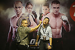 ONE VIP area during fight. Some punters act out scenes for photo opportunities in front of a poster of the MMA stars<br /><br />MMA. Mixed Martial Arts &quot;Tigers of Asia&quot; cage fighting competition. Top professional male and female fighters from across Asia, Russia, Australia, Malaysia, Japan and the Philippines come together to fight. This tournament takes place in front of a ten thousand strong crowd of supporters in Pelaing Stadium. Kuala Lumpur, Malaysia. October 2015