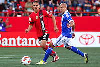 TIJUANA -MÉXICO, 10-04-2013. Jorge Hernández (i) del Tijuana y Juan Ortiz (i) de Millonarios durante el juego de la fase de grupos de la Copa Libertadores 2013 en el Estadio Caliente en Tijuana, Mexico./ Jorge Hernández (l) of Tijuana and Juan Ortiz (r) of Millonarios fights for tha ball during match of the groups stage of Libertadores Cup 2013 at Caliente stadium in Tijuana, Mexico.  Photo: Gonzalo Gonzalez/JAM MEDIA/VizzorImage
