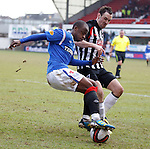 Sone Aluko stands on the ball as the flying winger twists and turns past David Graham