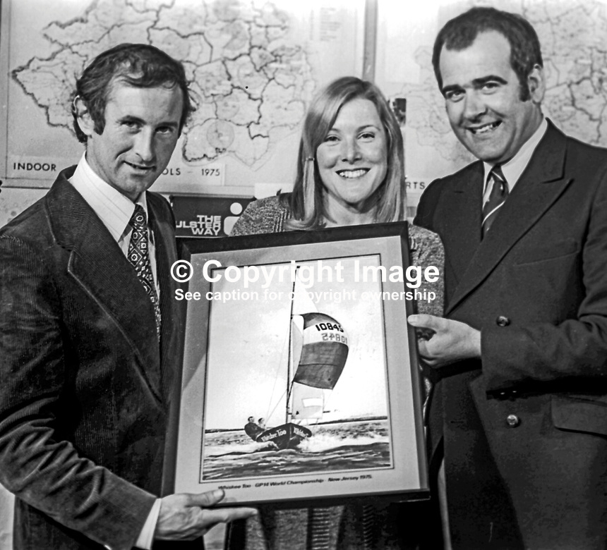 Maeve Bell, Sports Council of N Ireland, presents a painting of Whiskee Too to Bill Whicker, left, and Jim McKee in recognition of their winning a world sailing championship event in New Jersey, USA, in August 1975. 197510140697a<br /> <br /> Copyright Image from Victor Patterson, 54 Dorchester Park, Belfast, UK, BT9 6RJ<br /> <br /> t1: +44 28 9066 1296 (from Rep of Ireland 048 9066 1296)<br /> t2: +44 28 9002 2446 (from Rep of Ireland 048 9002 2446)<br /> m: +44 7802 353836<br /> <br /> e1: victorpatterson@me.com<br /> e2: victorpatterson@gmail.com<br /> <br /> www.victorpatterson.com<br /> <br /> IMPORTANT: Please see my Terms and Conditions of Use at www.victorpatterson.com